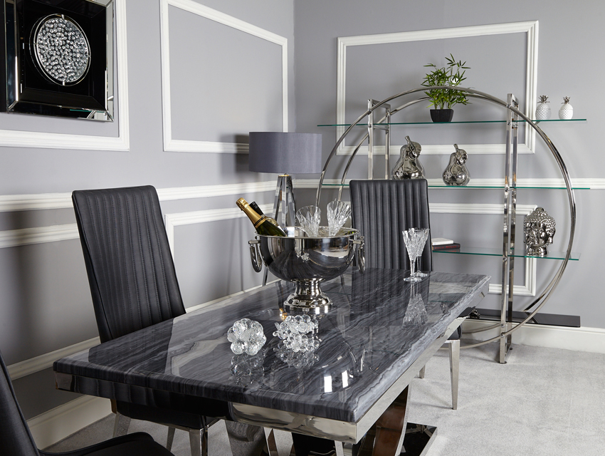 Stylish grey decorated room with dining table and chairs